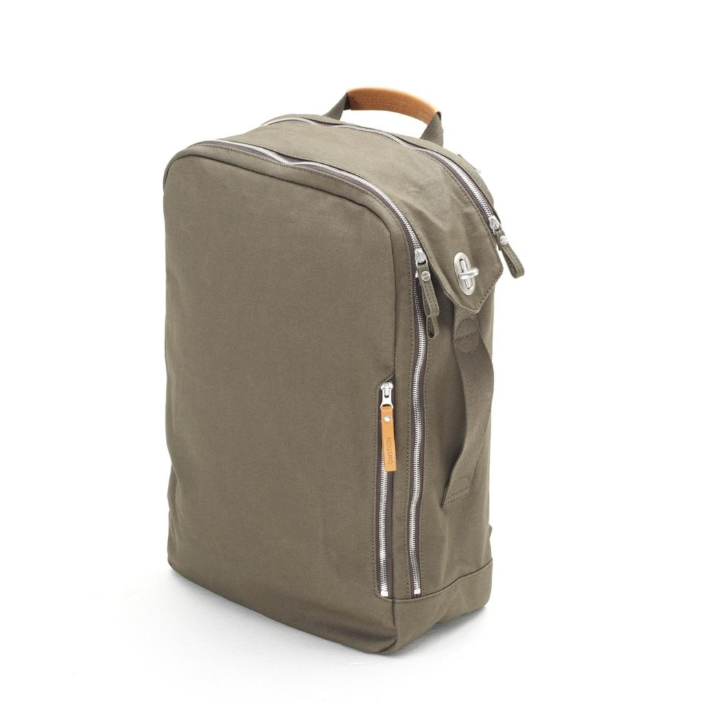 The QWSTION backpack in forest green can be used backpack-style or like a briefcase via the side-mounted carrying handles