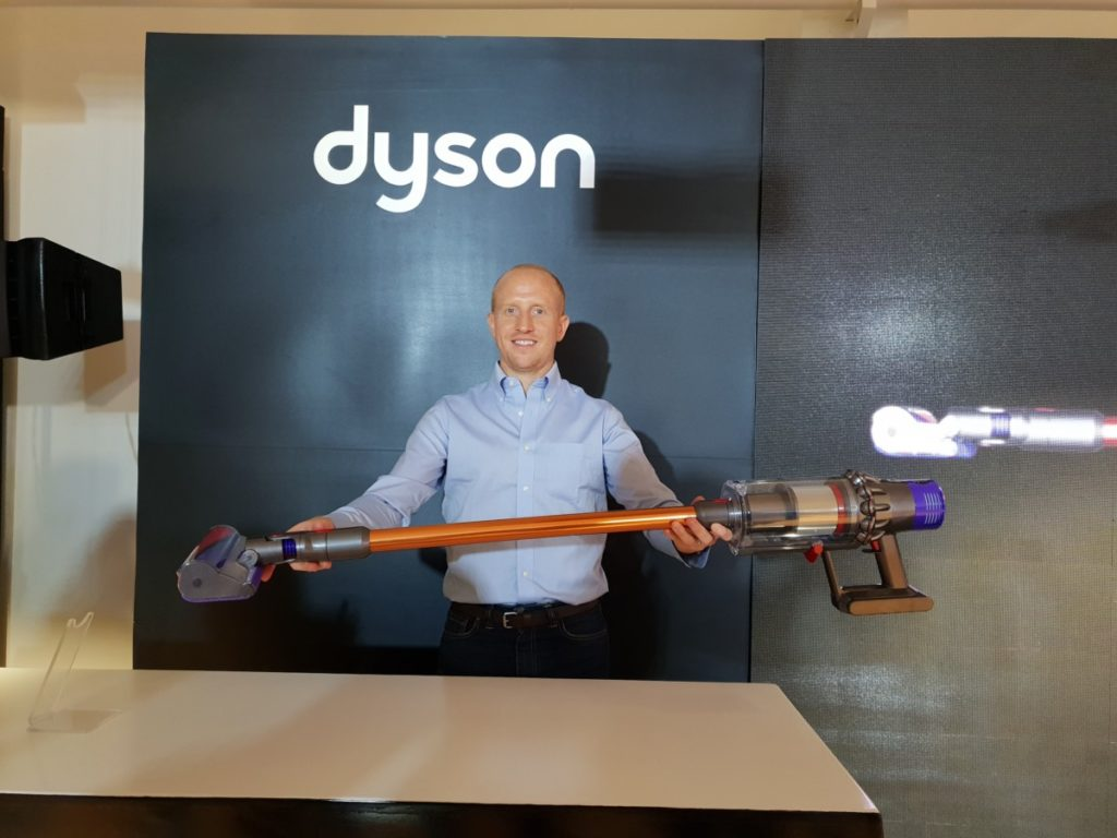 Kevin Grant, Head of Floorcare Category from Dyson showcasing the new Cyclone V10 vacuum cleaner