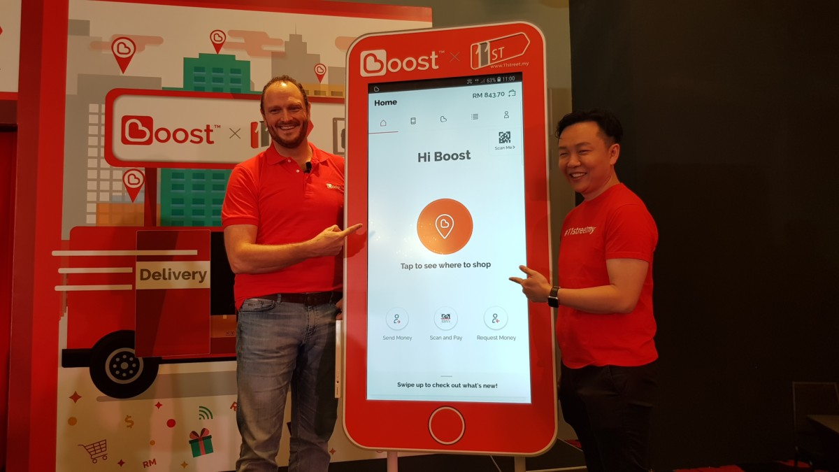 Christopher Tiffin, CEO of Boost and Cheong Chia Chou, CEO of 11street at the launch event