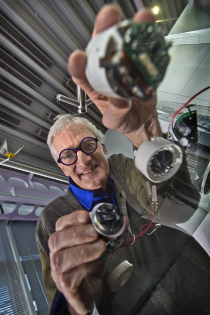 Sir James Dyson with examples of Digital Motors that go into a host of his products