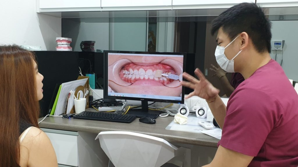 Dr. Chong briefs a patient on what to expect during the Zoom Teeth Whitening procedure.
