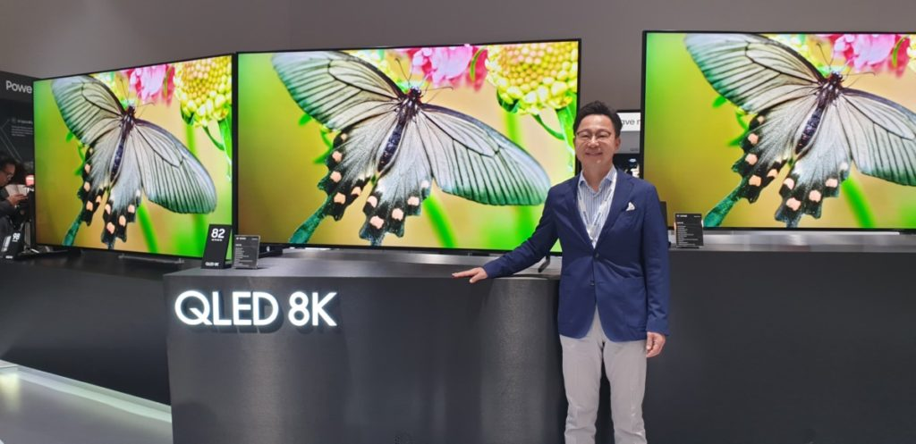 Mr Yoonsoo Kim, Samsung Malaysia Electronics President showcasing the new range of 8K QLED TVs