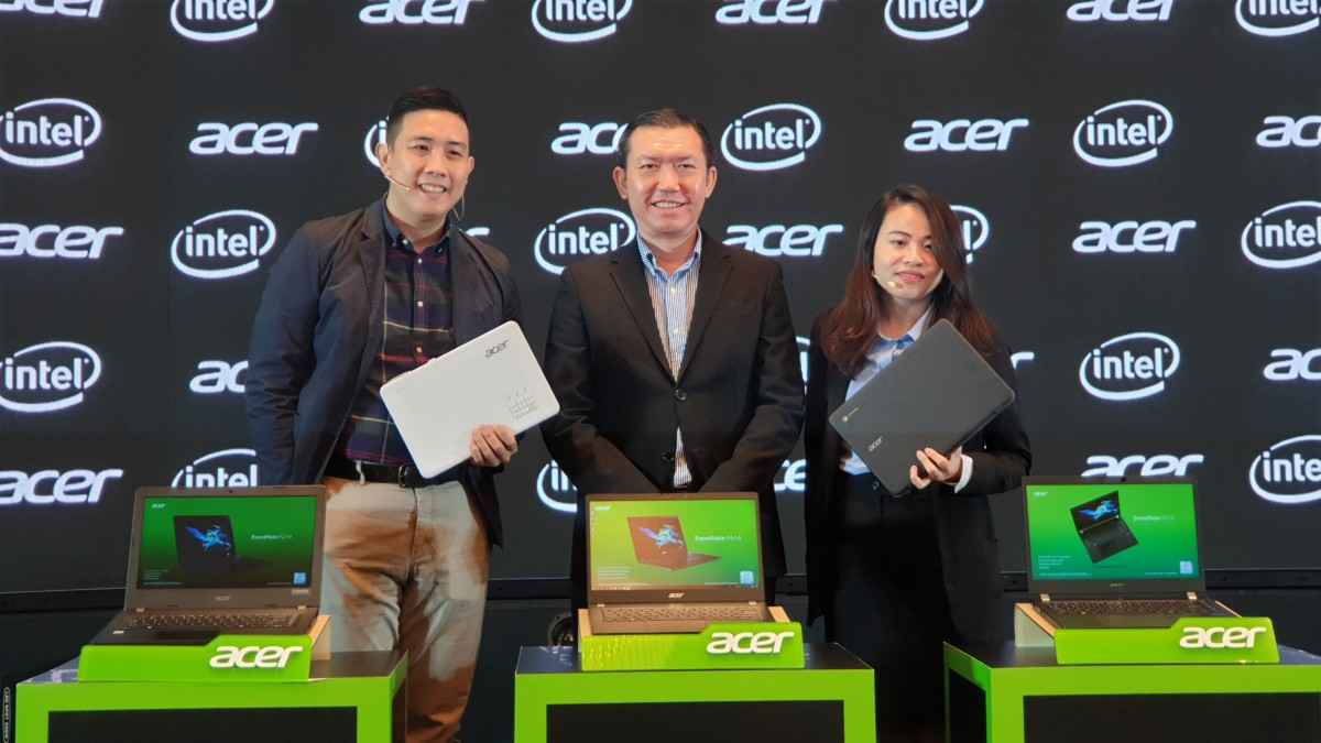 Acer representatives showcasing the latest TravelMate, Chromebook and PD series projector